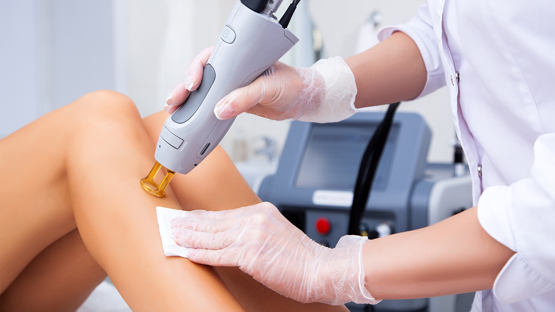 Young woman receiving laser hair removal